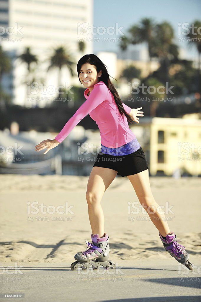 Young Hispanic Woman Rollerblading at Beach royalty-free stock photo