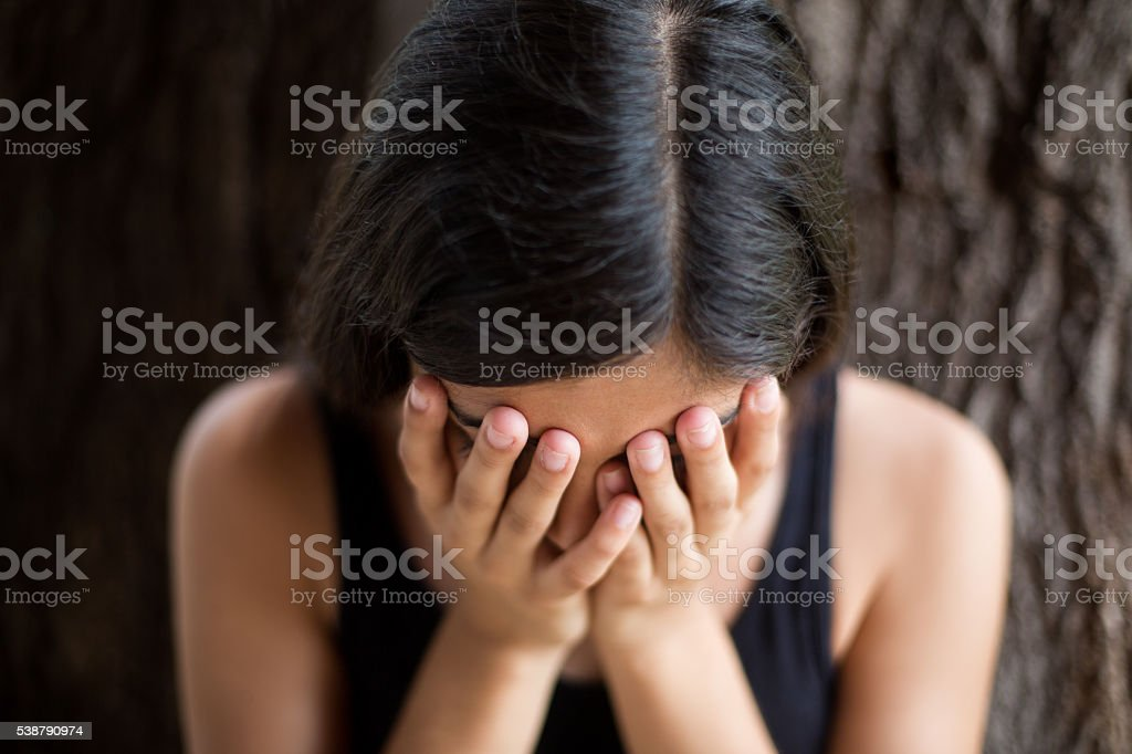 Young hispanic woman showing depression stock photo