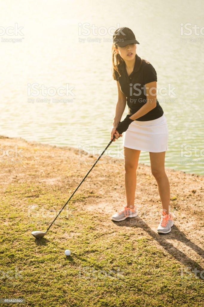 Young Hispanic Women Playing Golf stock photo