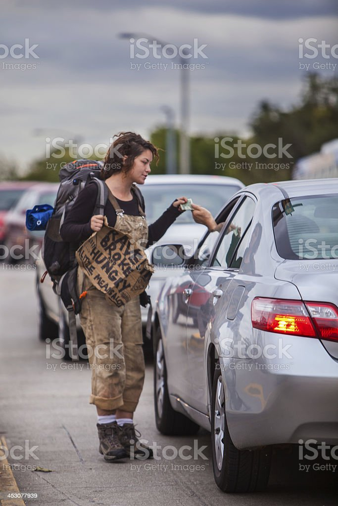 young hobo female with sign accepts handout royalty-free stock photo