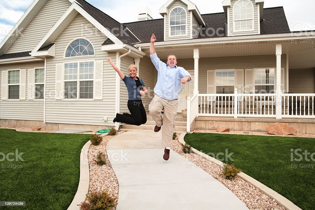 Young Home Owners Jumping for Joy stock photo