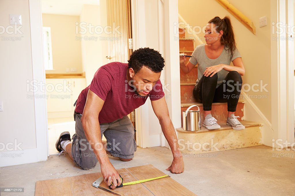 Young homeowners decorating their house stock photo