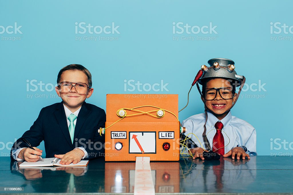 Young Honest Businessman is Tested with Lie Detector stock photo