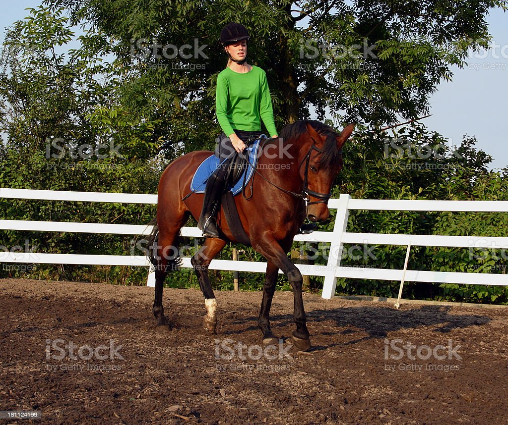 Young horsewoman riding royalty-free stock photo