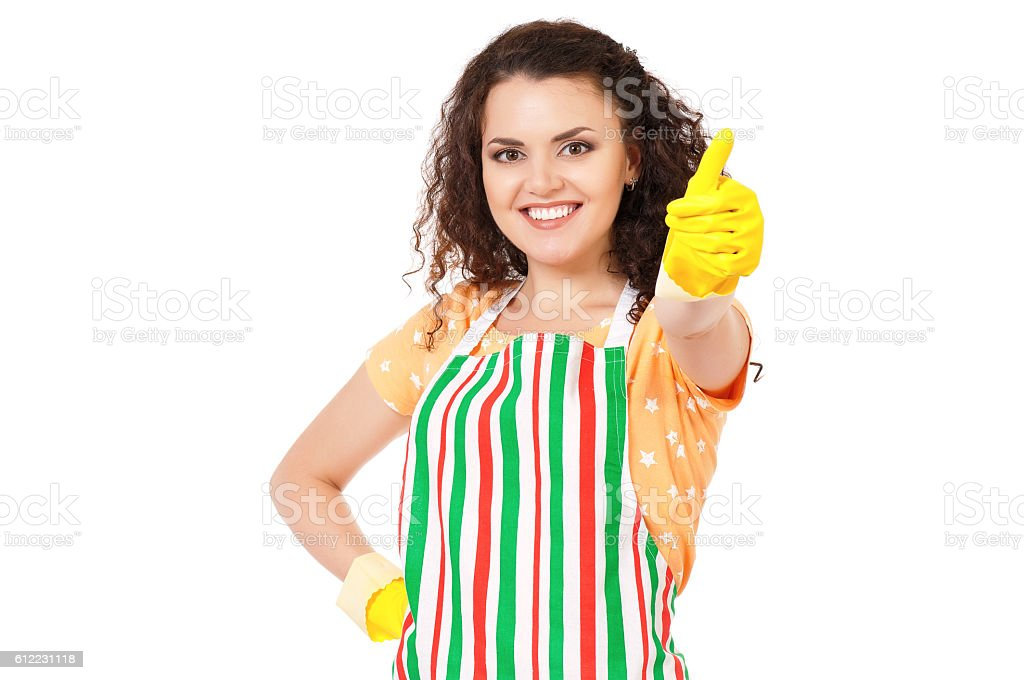 Young housewife with cleaning gloves stock photo