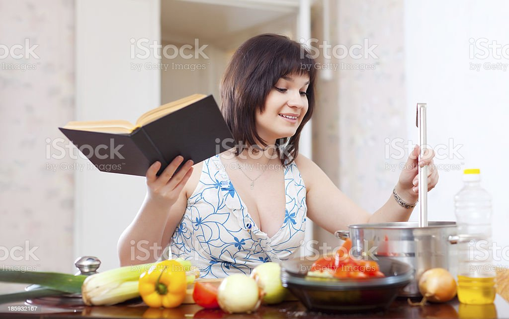 Young housewife  with cookery book royalty-free stock photo