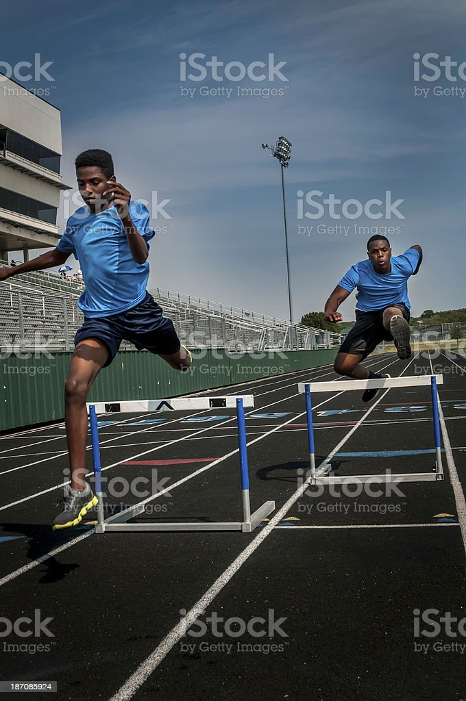 Young hurdle runners compete at the high scool race (I) stock photo