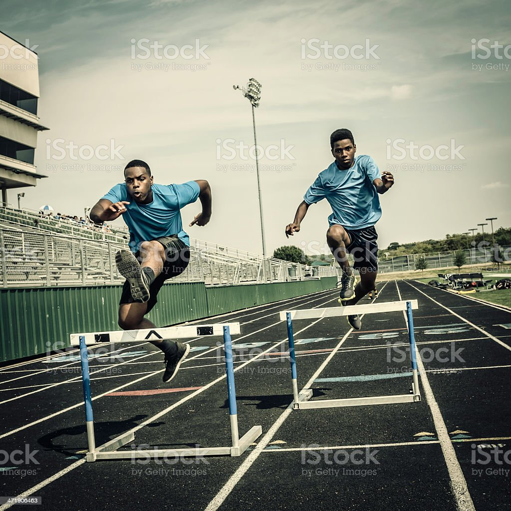 Young hurdle runners compete at the high scool race (III) stock photo