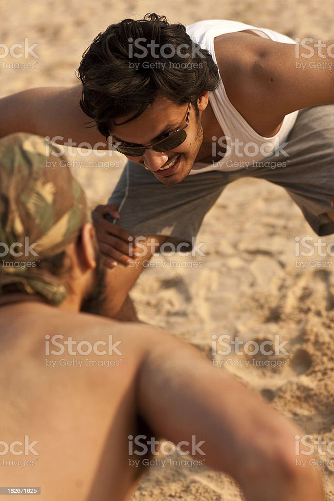 Young Indian beach wrestlers stock photo