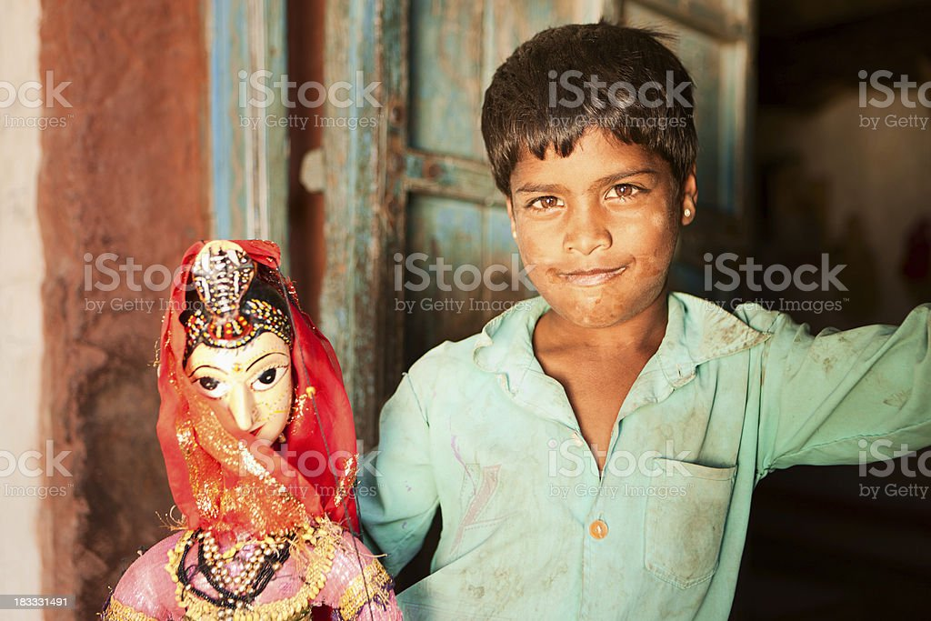 Young Indian boy playing with puppet. Rajasthan. India. royalty-free stock photo