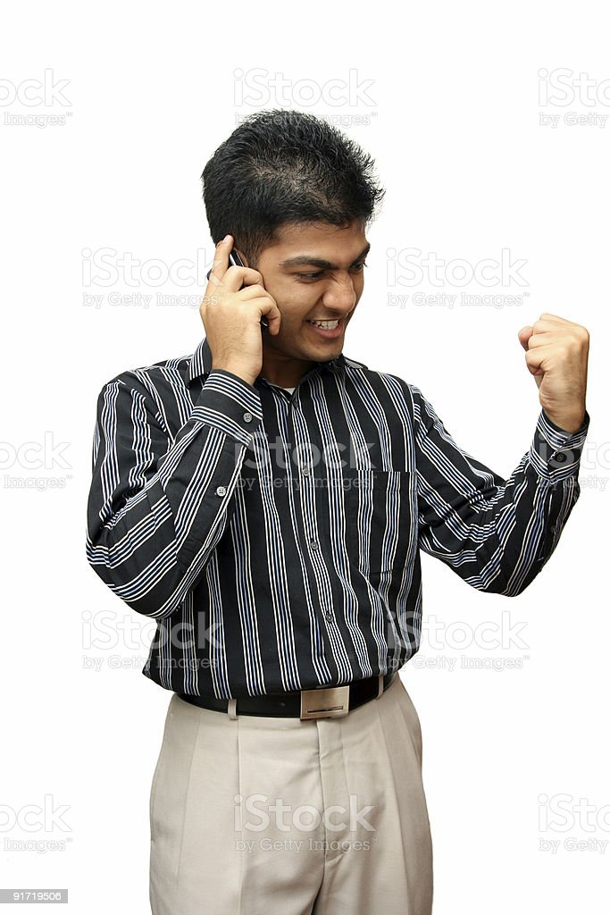 Young Indian business man using cellphone royalty-free stock photo
