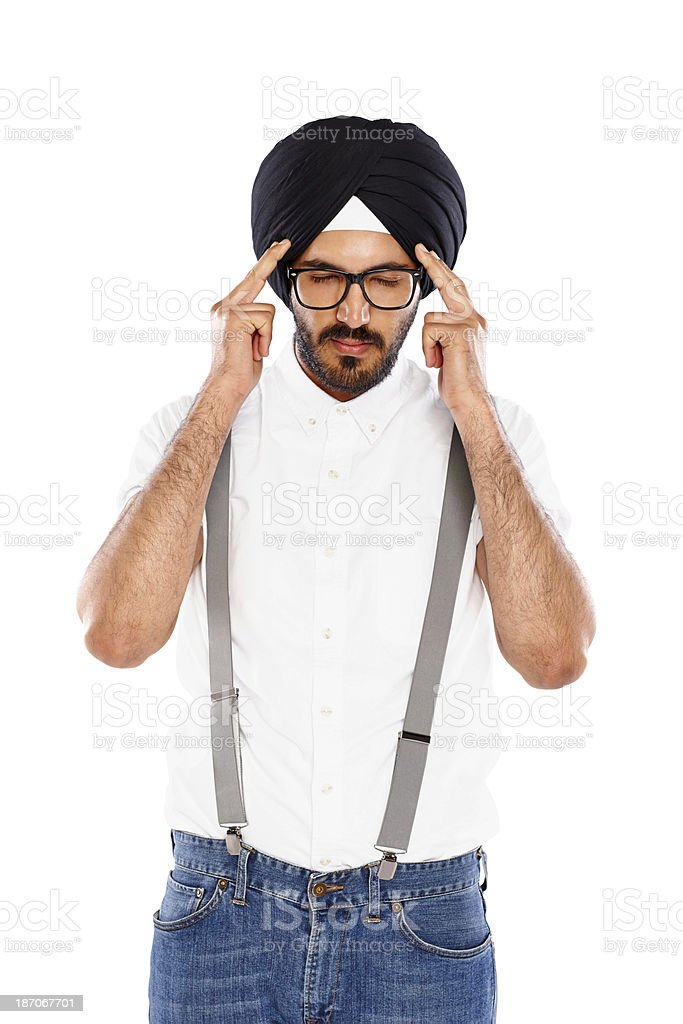 Young Indian businessman suffering from headache royalty-free stock photo