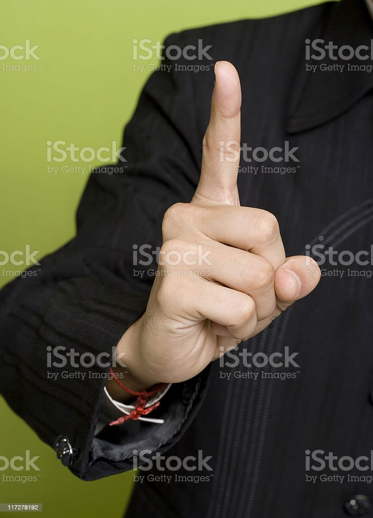 Young Indian Businessman with a Hand Sign We are No.1 royalty-free stock photo