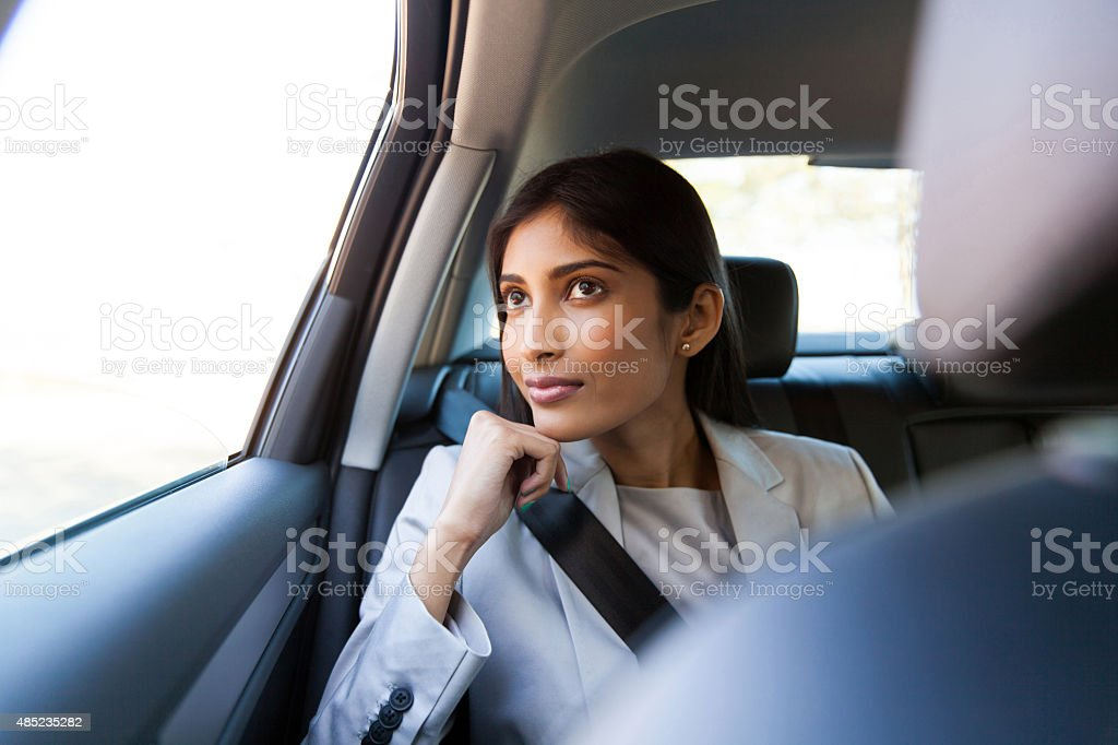 young indian businesswoman sitting in car stock photo