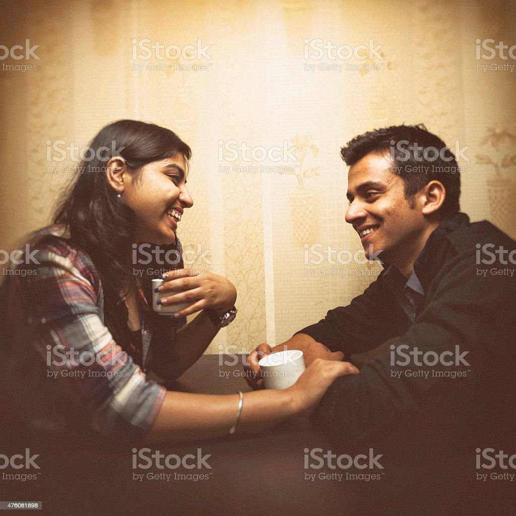 Young Indian couple having coffee in a cafe stock photo