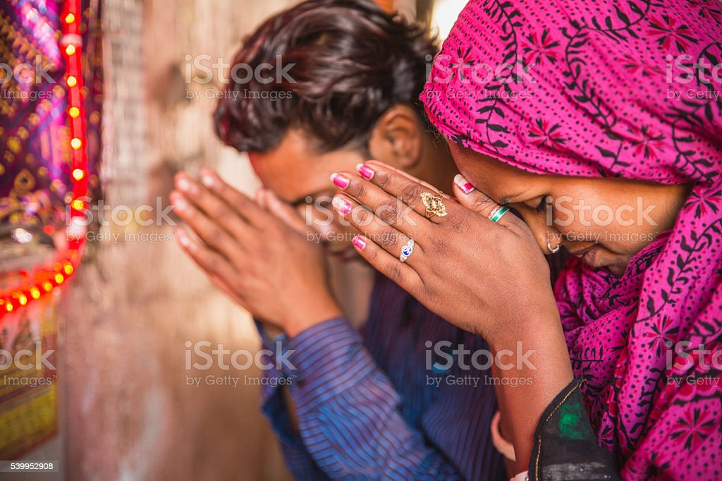 Young Indian couple praying stock photo