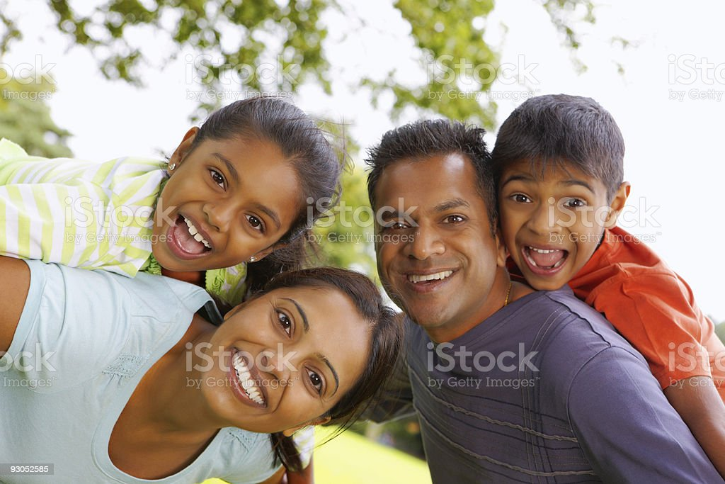 Young Indian Family having fun outdoors royalty-free stock photo