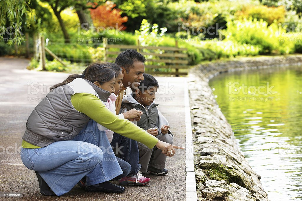 young Indian Family spening the day outdoors in a park royalty-free stock photo