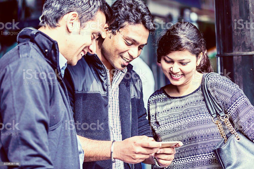 Young Indian Friends Sharing Video on Mobile Phone stock photo