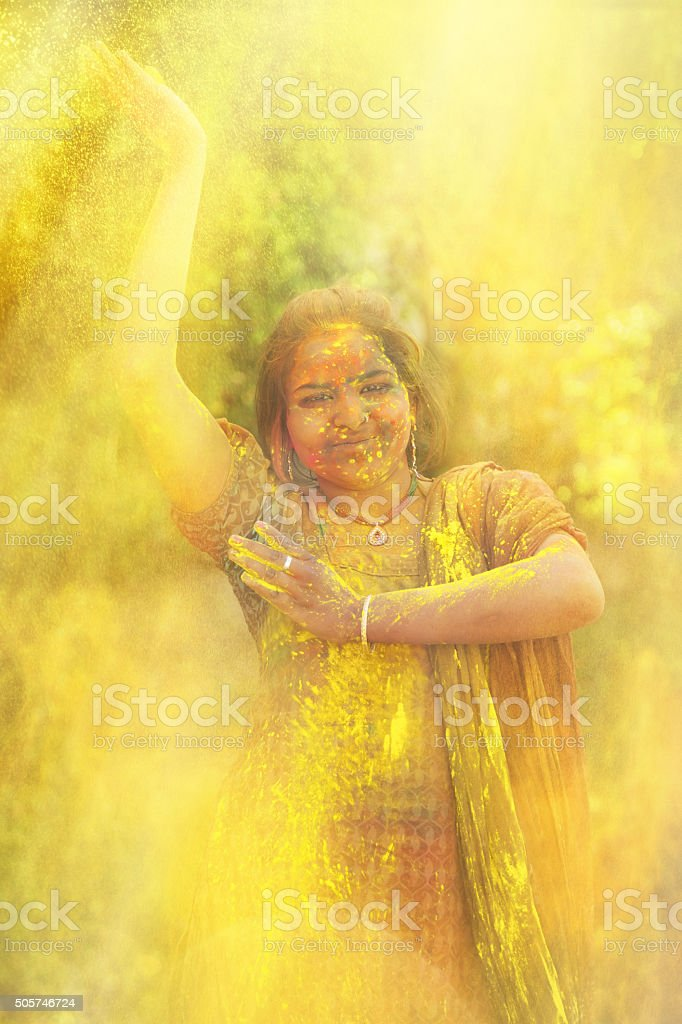 Young indian girl celebrating holi festival in India stock photo