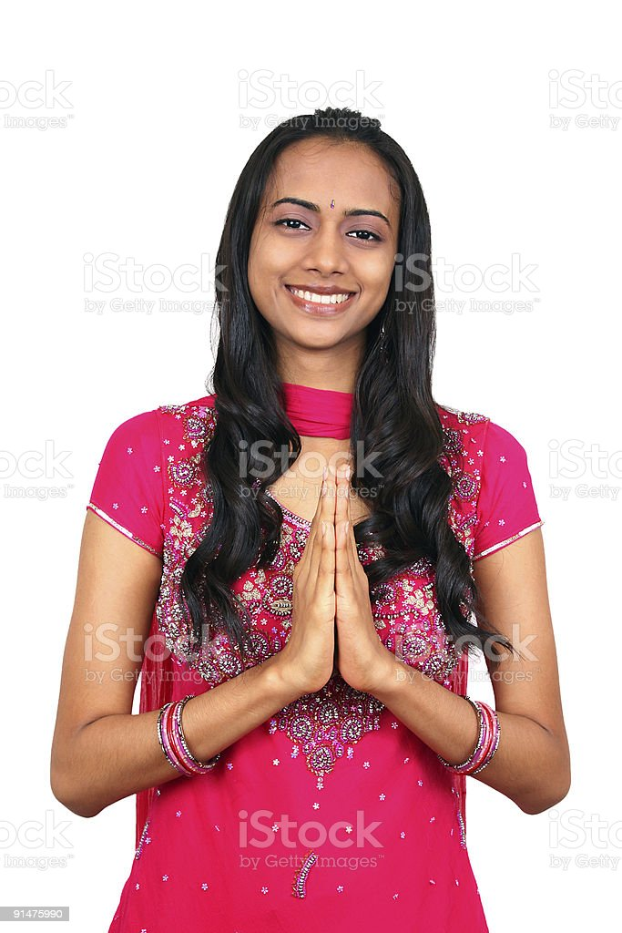 Young Indian girl in namaste pose. royalty-free stock photo