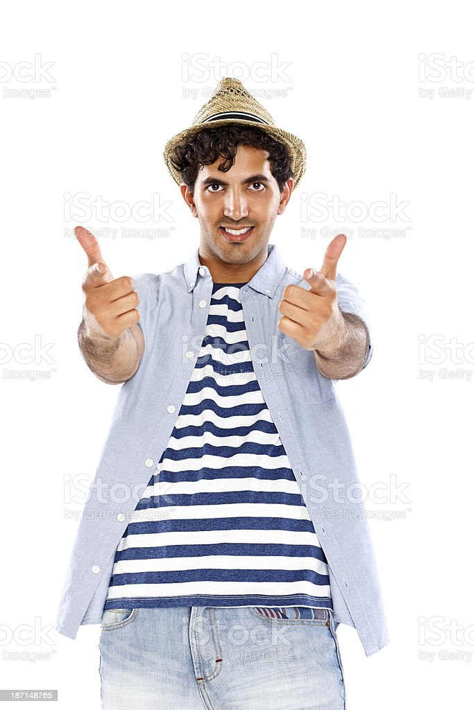 Young Indian guy  in summer outfit pointing at you royalty-free stock photo