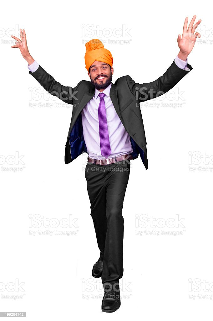 Young Indian male doing Bhangra dance stock photo