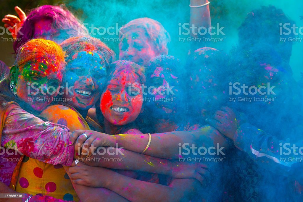young indian people celebrating holi festival stock photo