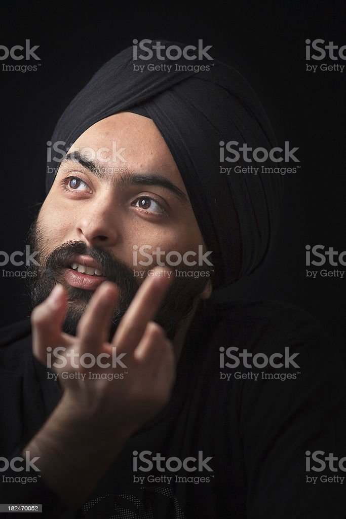 Young Indian Sikh looking away questioning stock photo