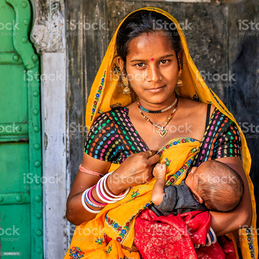 Young Indian woman breastfeeding her newborn baby, Amber, India stock photo