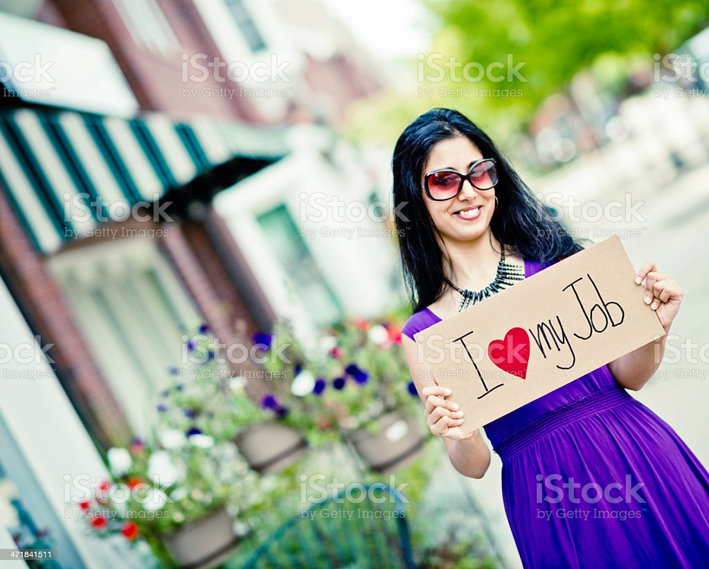 Young Indian Woman Expressing Job Satisfaction royalty-free stock photo
