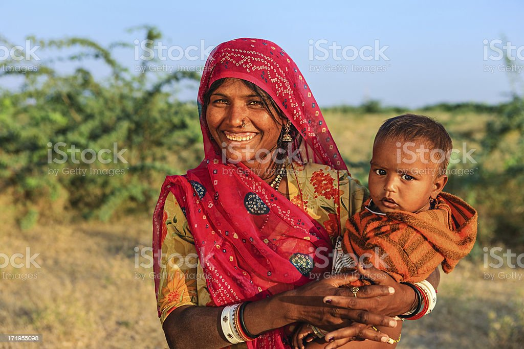 Young Indian woman holding her child royalty-free stock photo