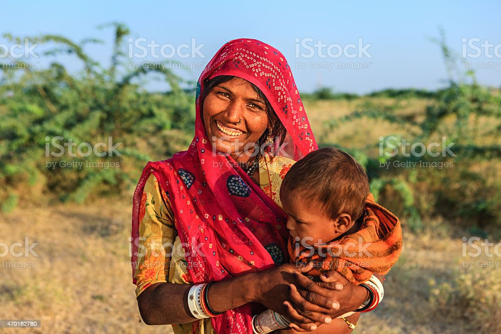 Young Indian woman holding her child stock photo