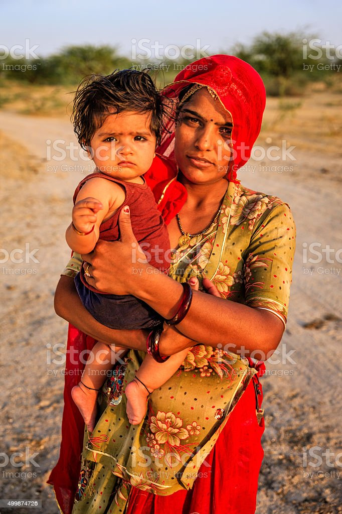 Young Indian woman holding her little baby, Amber, India stock photo