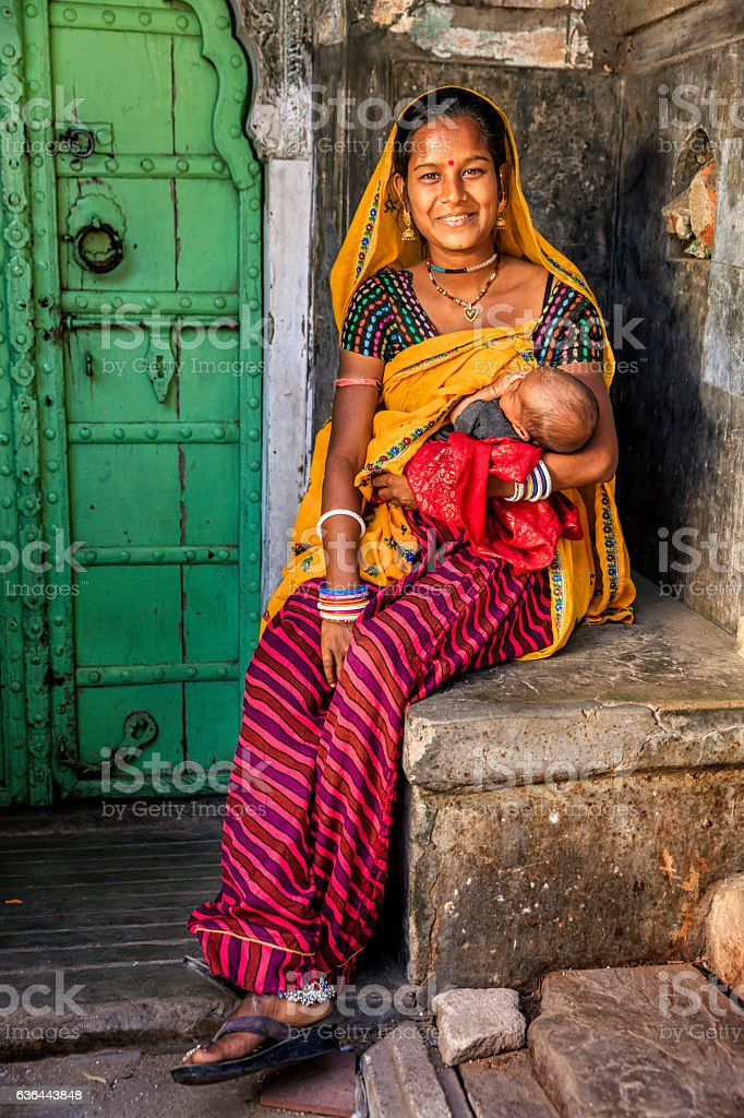 Young Indian woman holding her newborn baby, Amber, India stock photo
