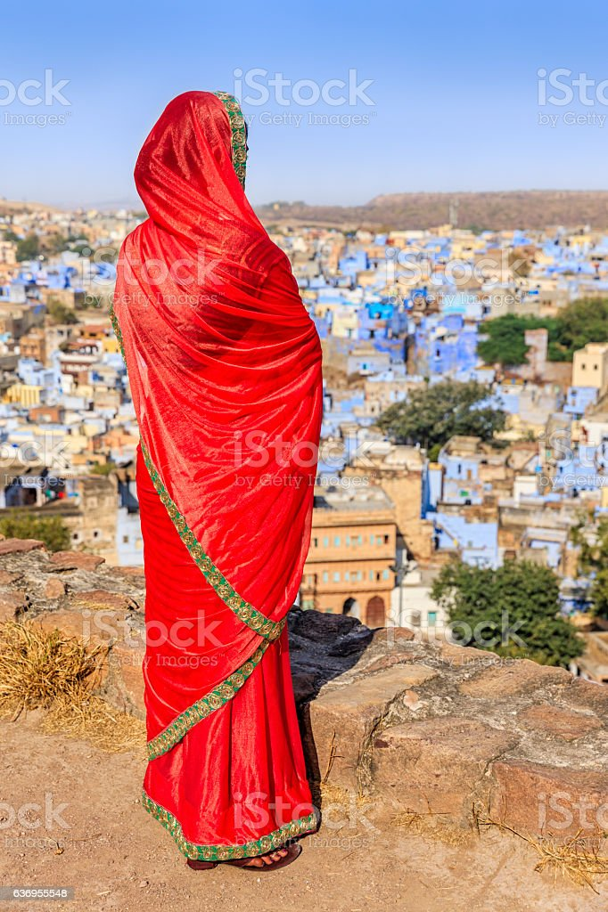 Young Indian woman looking at the view, Jodhpur, India stock photo