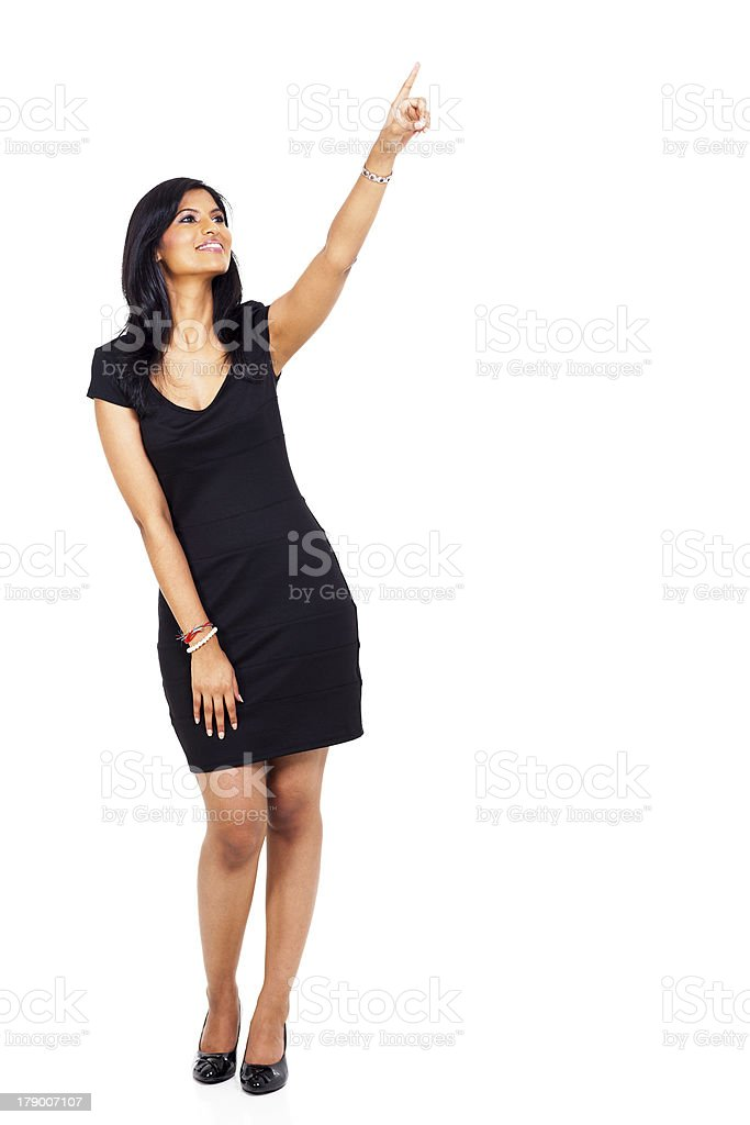 young indian woman pointing up royalty-free stock photo