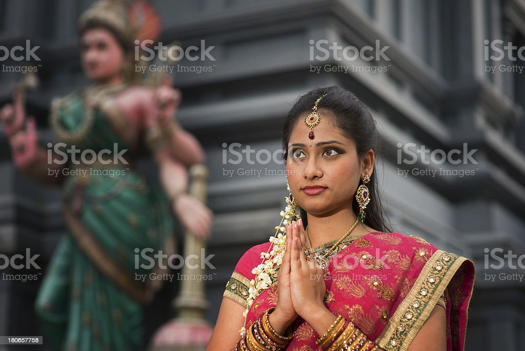 Young Indian woman praying royalty-free stock photo