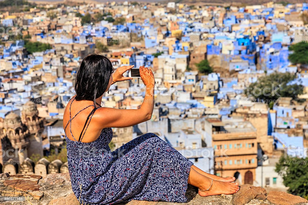 Young Indian woman taking picture using mobile phone, Jodhpur, India stock photo