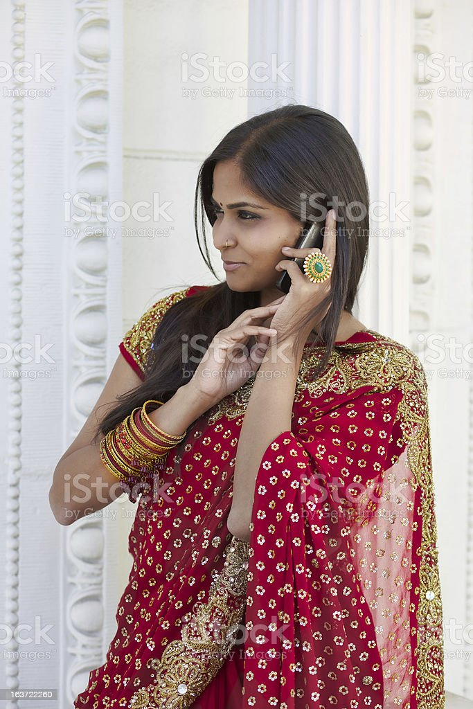 Young Indian Woman Talking on Cell Phone royalty-free stock photo