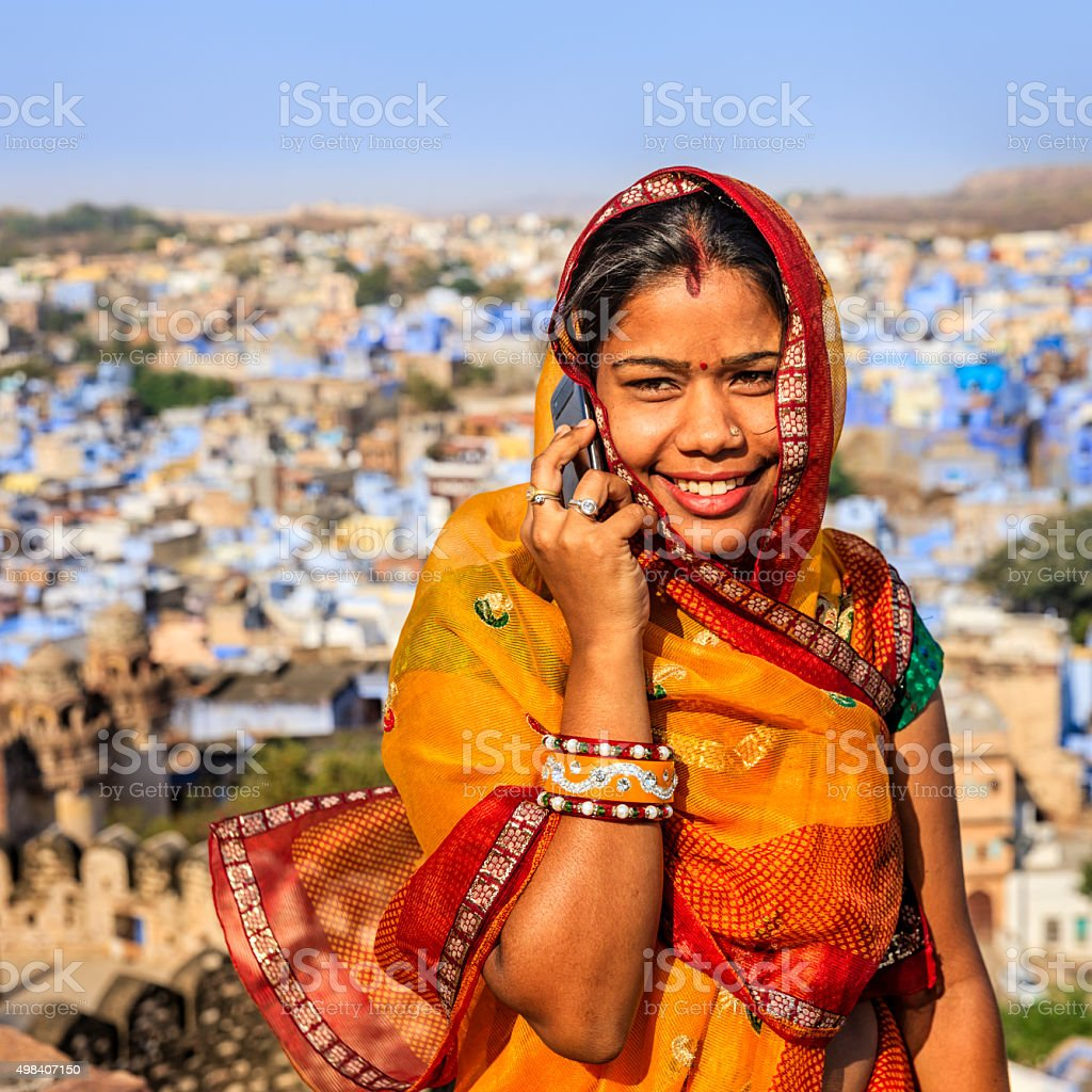 Young Indian woman using mobile phone, Jodhpur, India stock photo