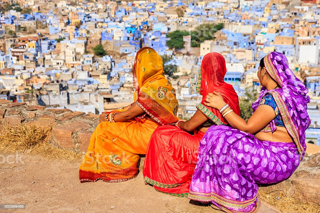 Young Indian women looking at the view, Jodhpur, India stock photo