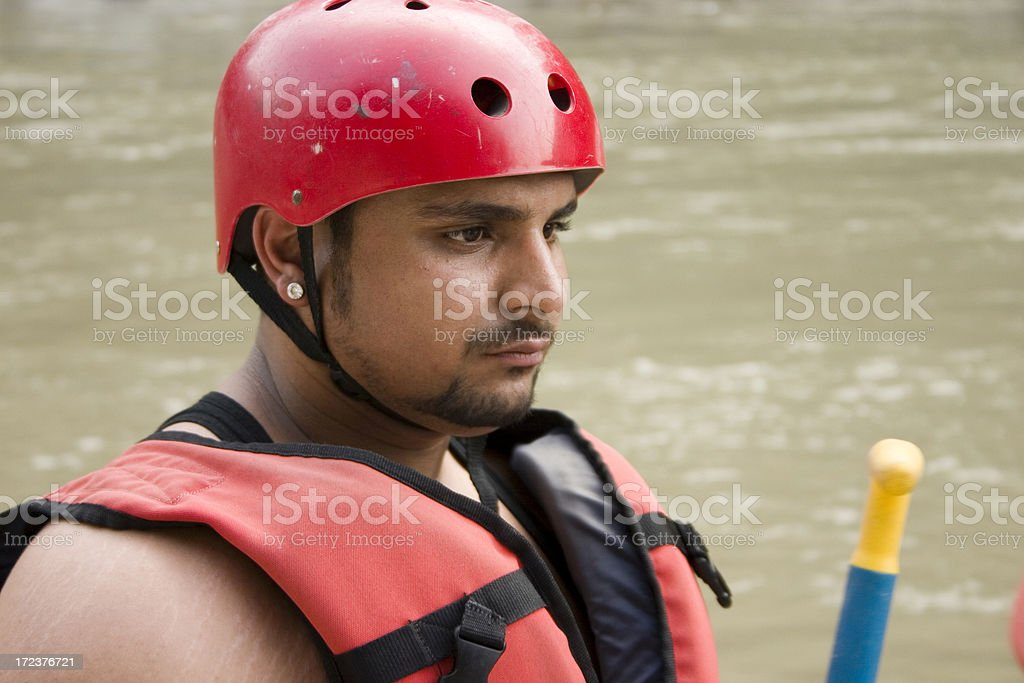 Young Indian youth guy set ready for White Water Rafting royalty-free stock photo