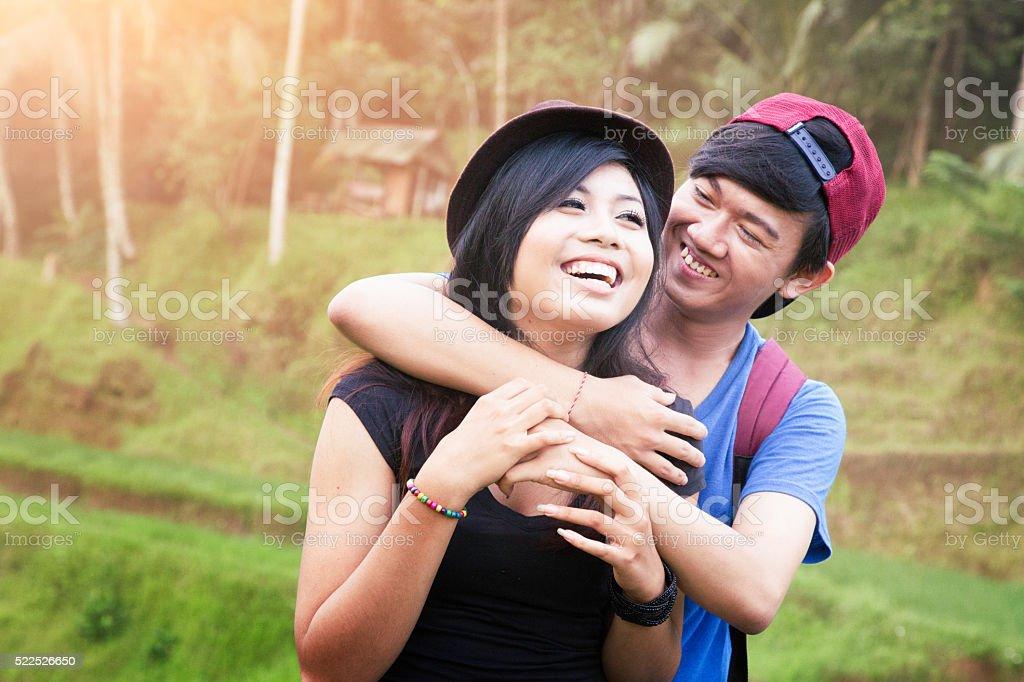 Young Indonesian couple having fun visiting Bali rice paddy stock photo