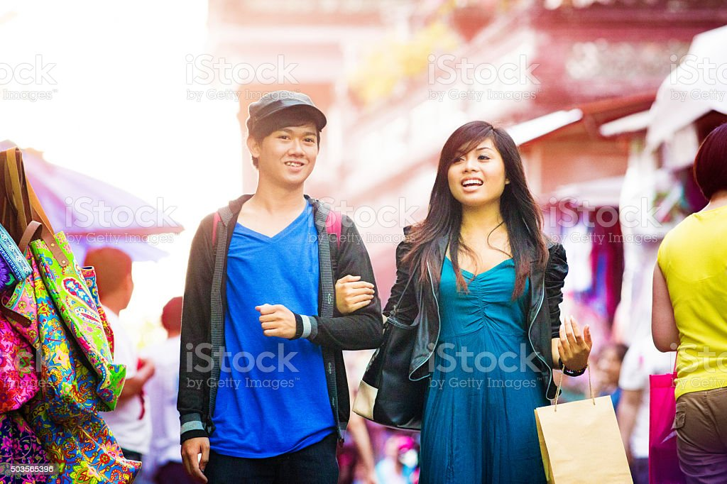Young Indonesian friends shopping at street market stock photo