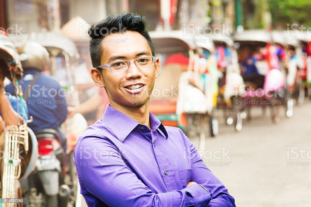 Young Indonesian male worker portrait in blue shirt Yogyakarta stock photo