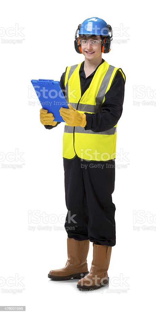 young industry worker checking docket royalty-free stock photo