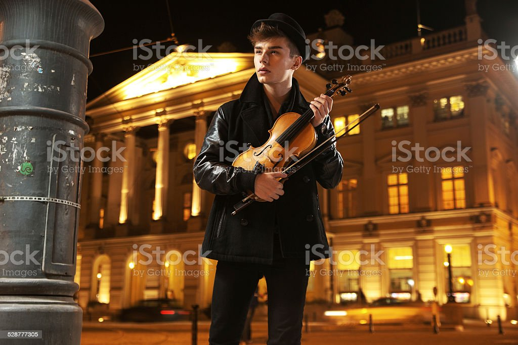 Young innocent musician with violin stock photo