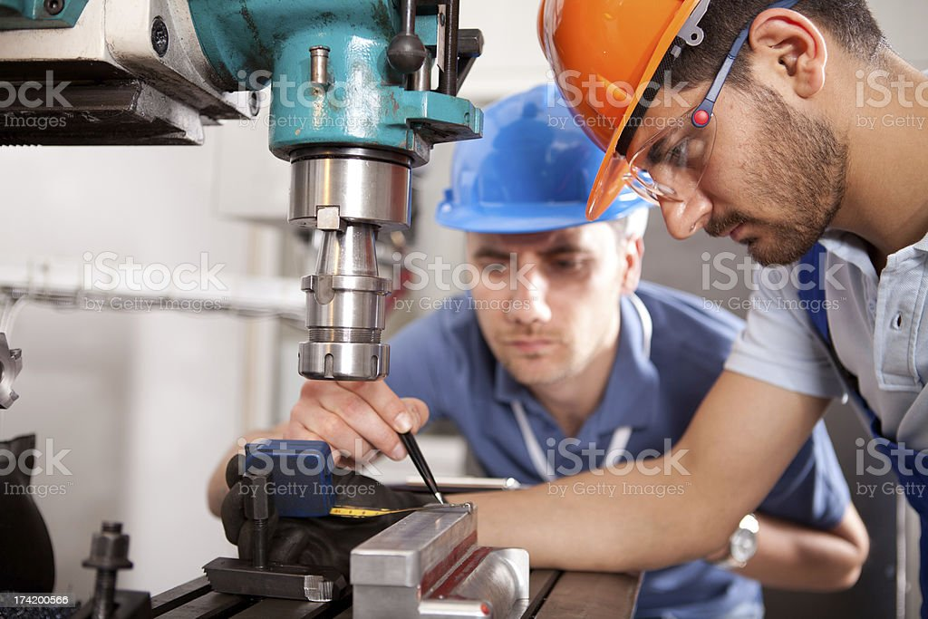 Young Inspector and Manual Worker royalty-free stock photo