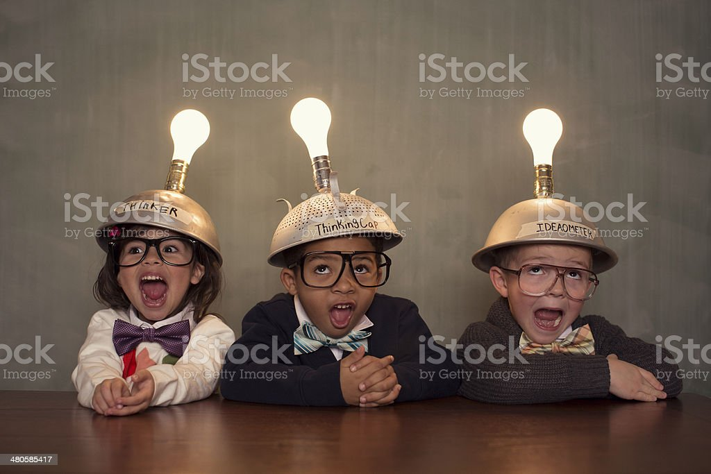 Young Intelligent Children Nerds wearing Thinking Caps stock photo